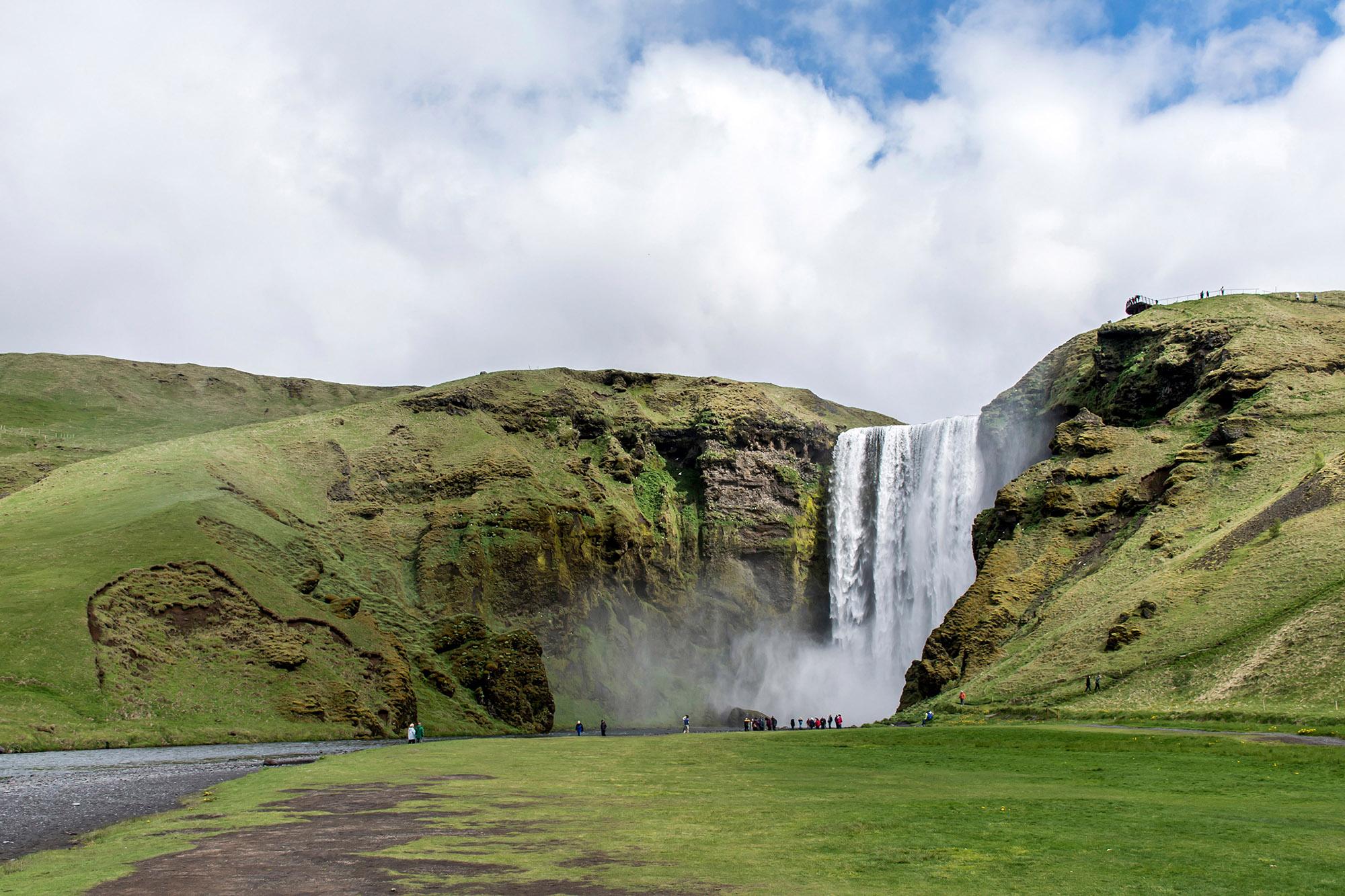 Skogafoss big beautiful waterfall in green Iceland Summer