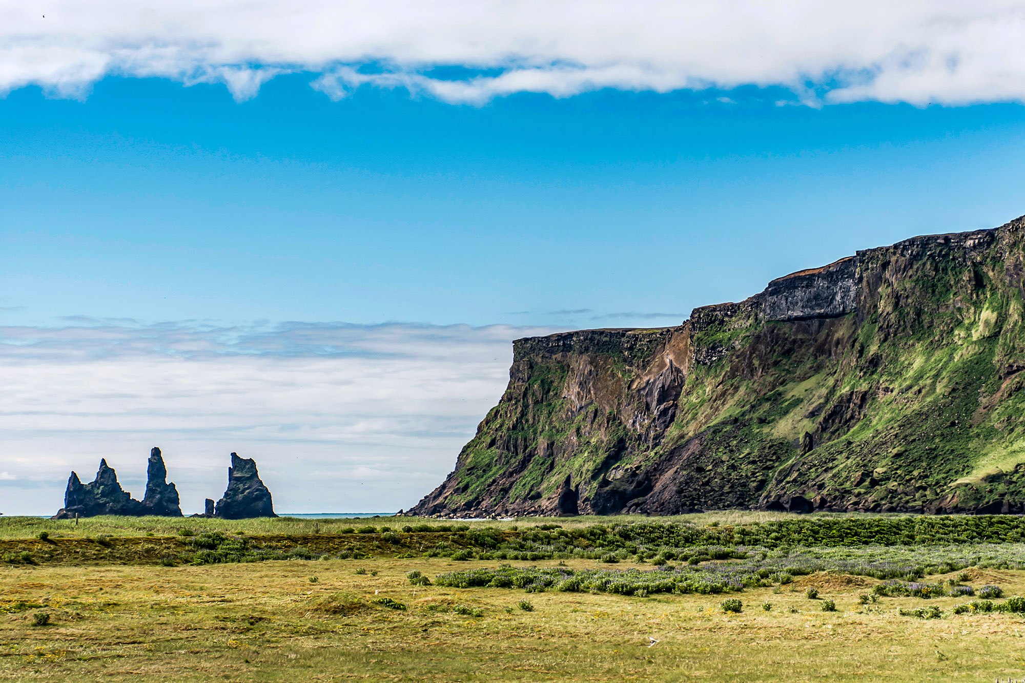 Epic surreal Landscape in Iceland with green grass and rocks