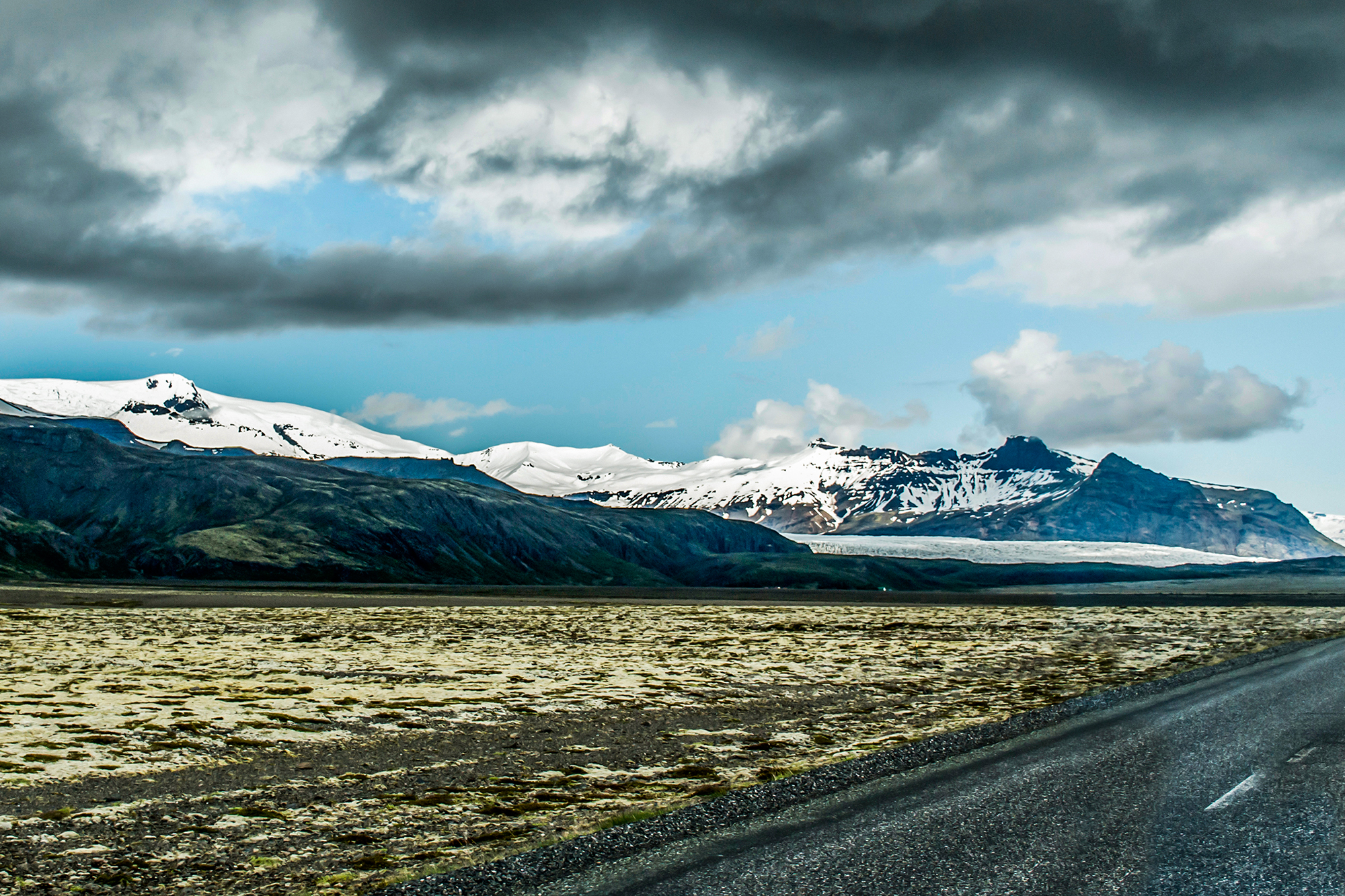 Epic Landscape in Iceland with green grass and snow glacier 6
