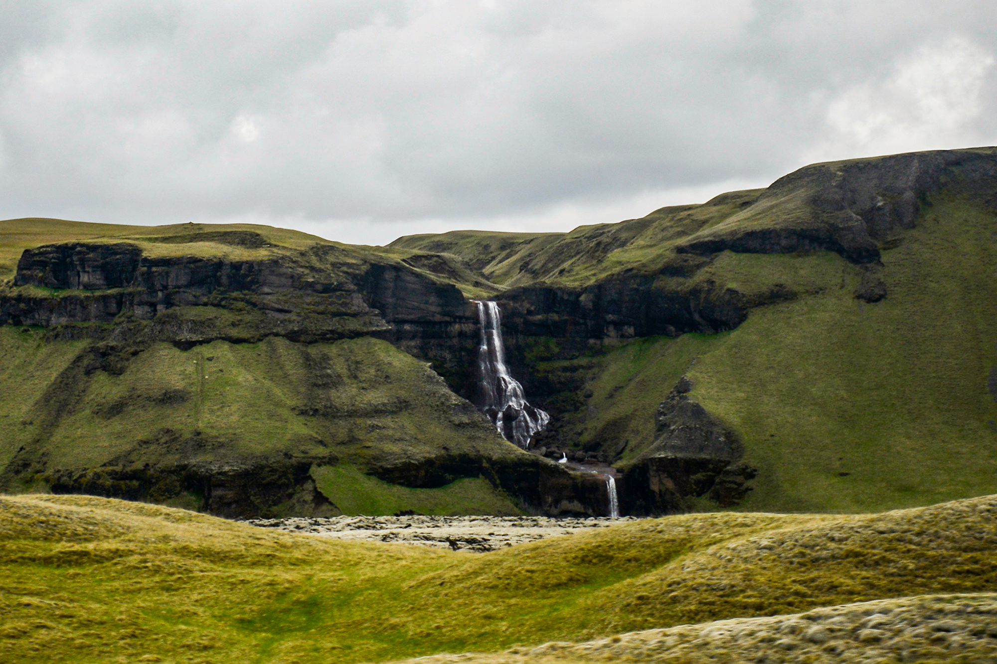 Epic Landscape in Iceland with green grass and mountain huge waterfall