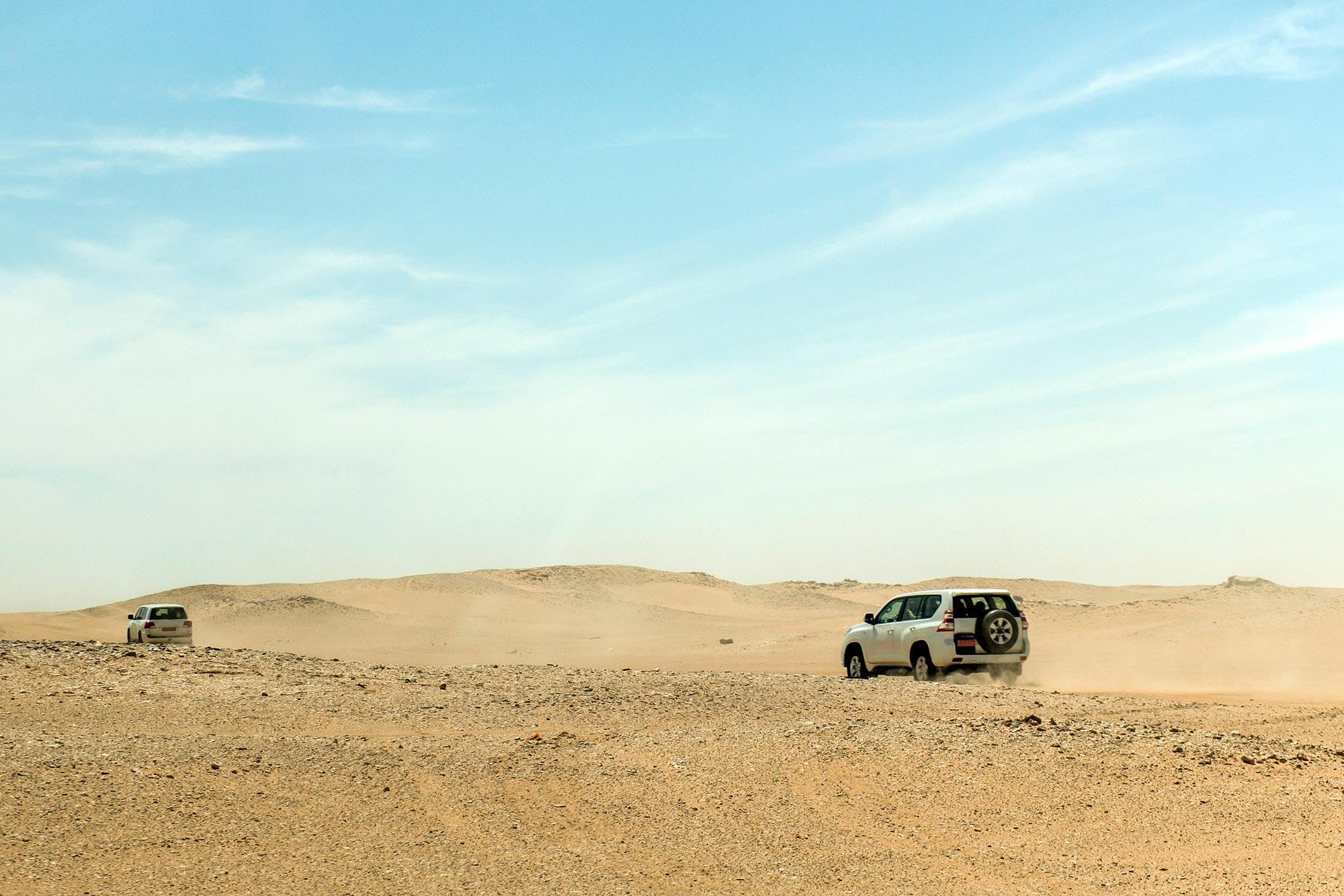 Jeeps traditional Safari Dune Bashing with tourists Oman Ubar in Desert Rub al Khali